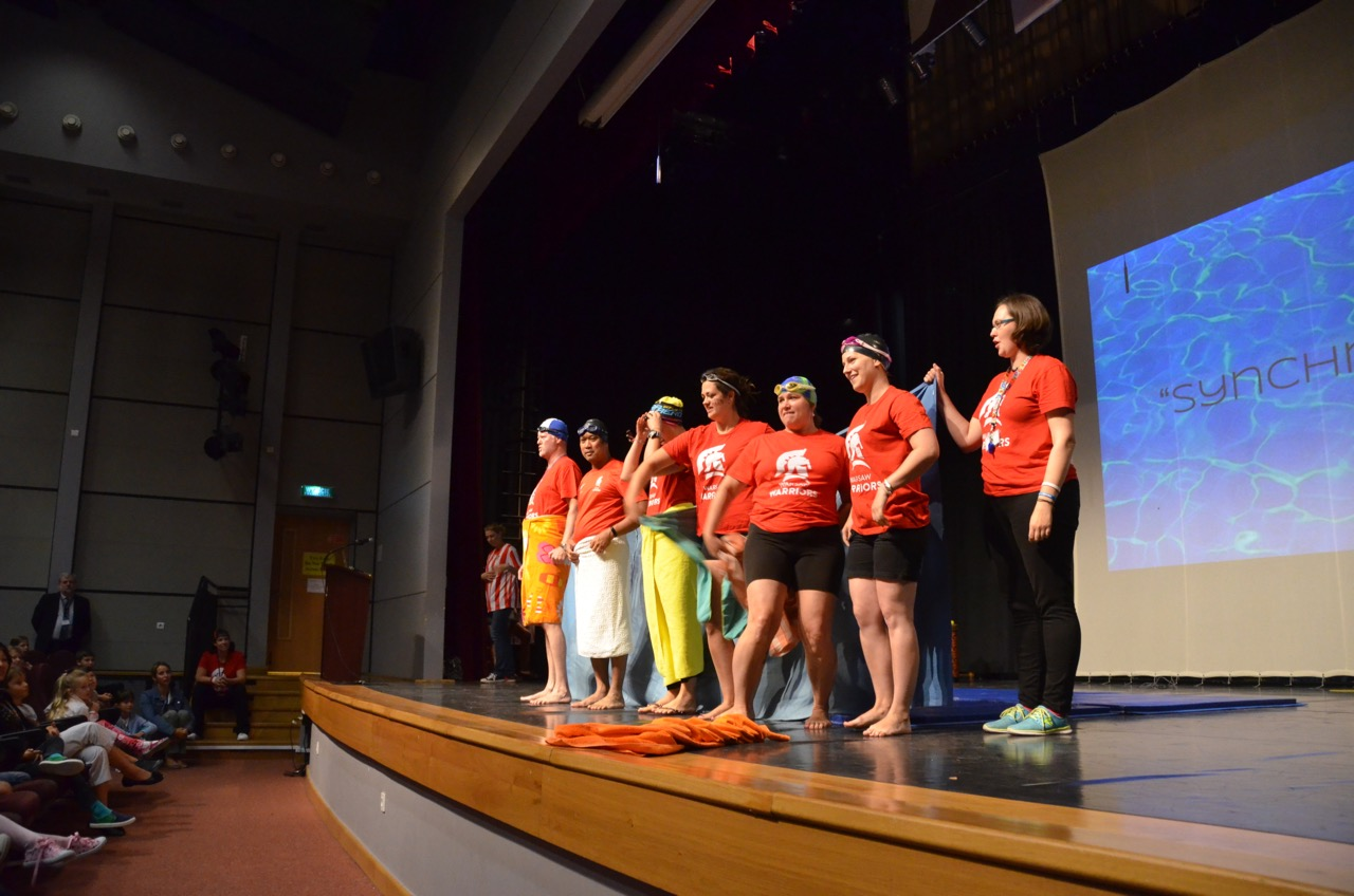 ASW teachers on the stage before performing for the Elementary School students