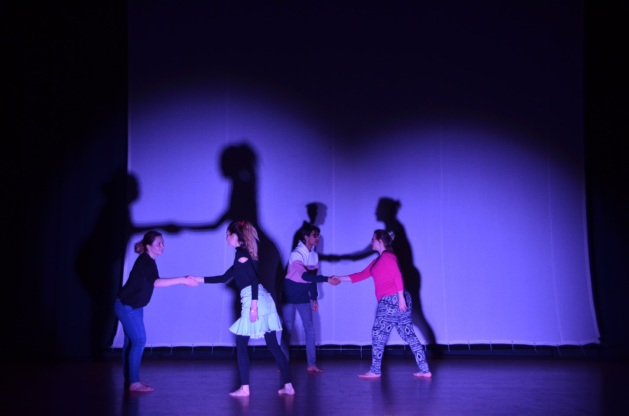 Students participate in a physical theatre workshop