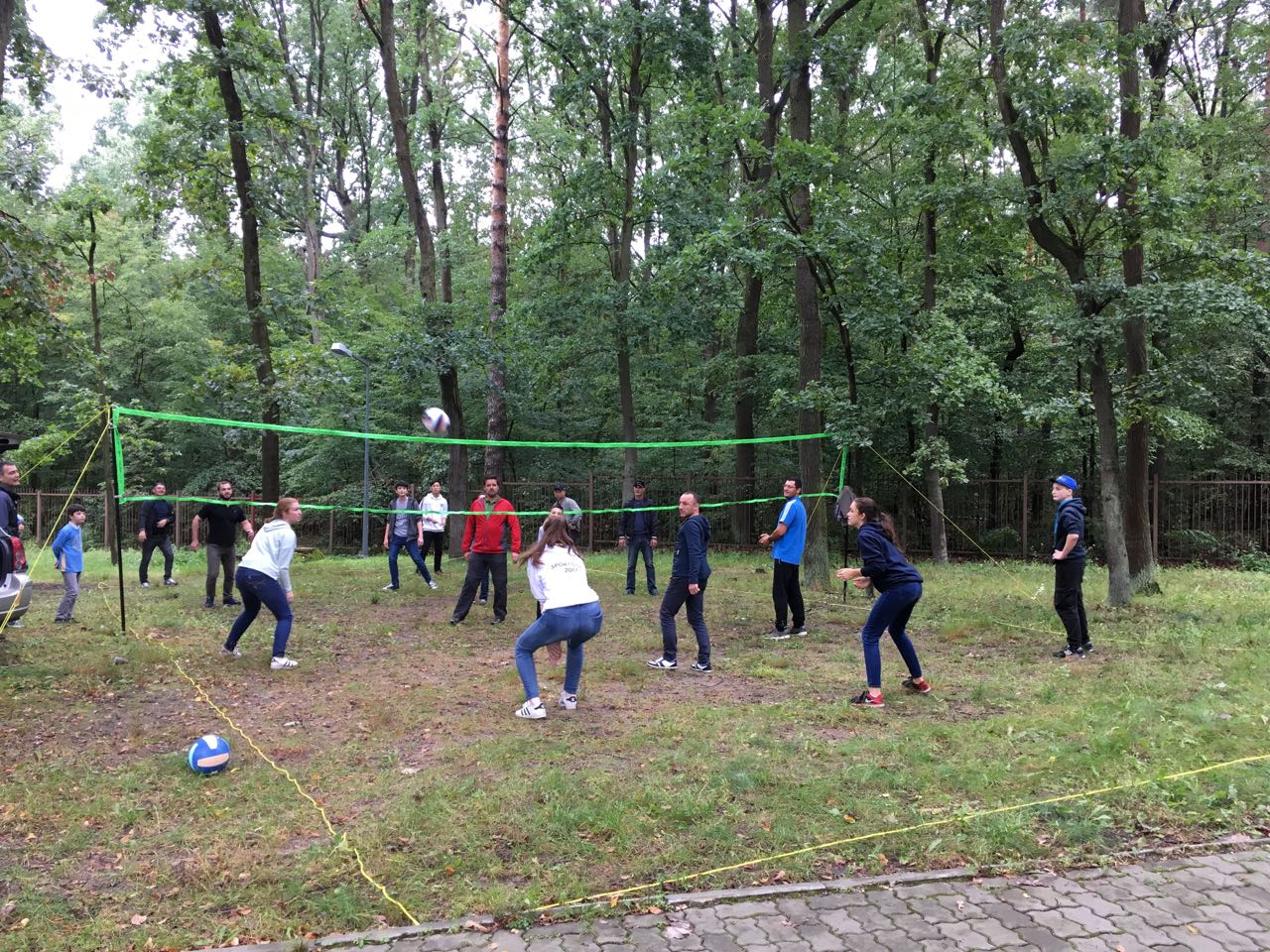 ASW students lead a game of volleyball with residents at the refugee center in Dębak