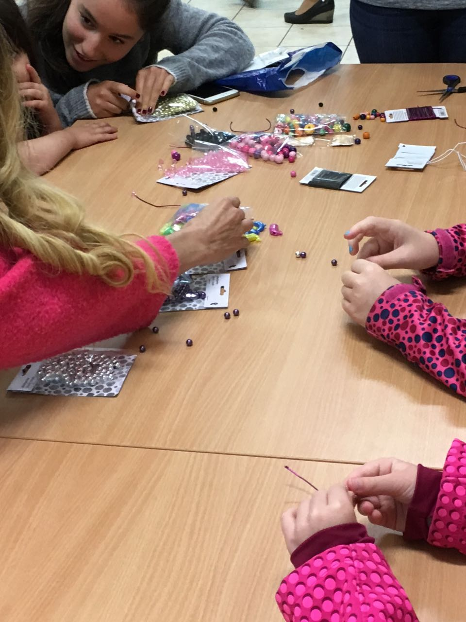 ASW students lead a craft making workshop with residents at the refugee center in Dębak